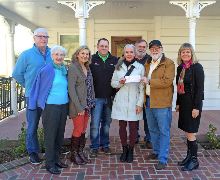 Carpe Vino co-owner Gary Moffat presents a check for $5,000 to Placer Community Foundation board member, Ellen MacInnes, on the front porch of the company offices in a restored Victorian in Old Town Auburn. Pictured from left, PCF board members Larry Welch, Ruth Burgess and Pam Constantino; Carpe Vino co-owner Drew Moffat; Ellen MacInnes; PCF board member Ken Larson; Gary Moffat; and PCF CEO Veronica Blake.
