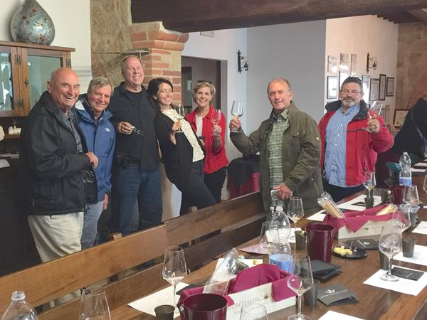 Pressing on, members of Carpe Vino's Tuscany tour  prepare for yet another tasting in Italy.